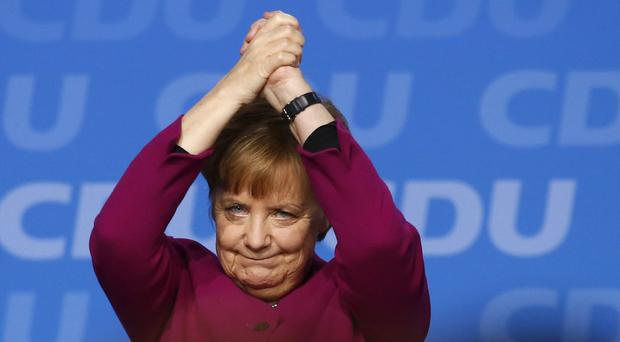 German Chancellor and CDU party chairwoman Angela Merkel had faced some criticism over weak election results (AP)