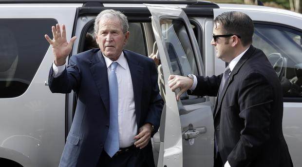 George W Bush arrives to pay his respects to Billy Graham (AP/Chuck Burton)