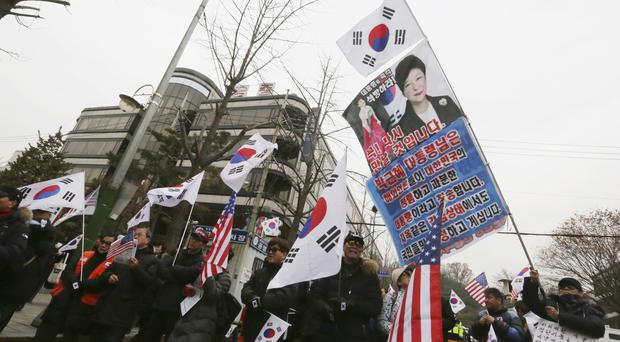 Supporters of Park Geun-hye attend a rally to call for her release in front of the Seoul Central District Court (AP Photo/Ahn Young-joon)