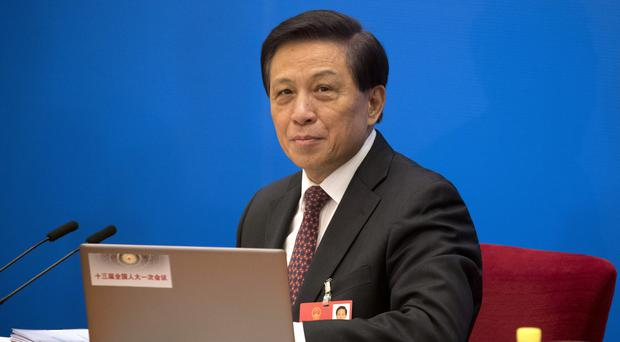 Zhang Yesui, a spokesman for the National People's Congress (Ng Han Guan/AP)