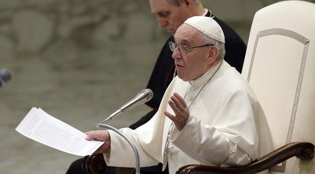 Pope Francis talks during the weekly general audience (Alessandra Tarantino/AP)