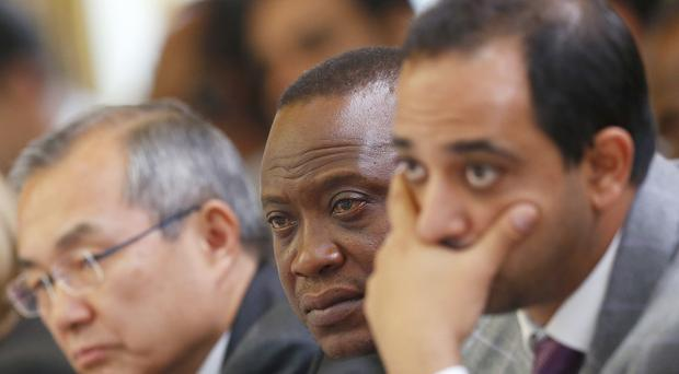 File picture of Ururu Kenyatta (centre) at a summit (Andrew Winning/PA)