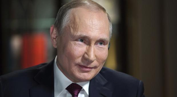 Mr Putin said he approved a plan to shoot down the aircraft, which had more than 100 people on board (AP)