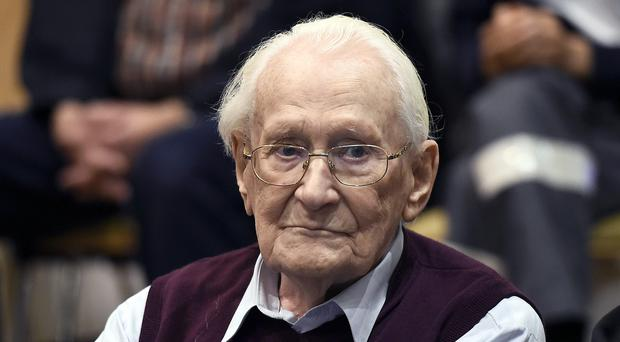 Oskar Groening waits for the verdict of his trial at a court in Lueneburg (Tobias Schwarz/pool photo via AP)
