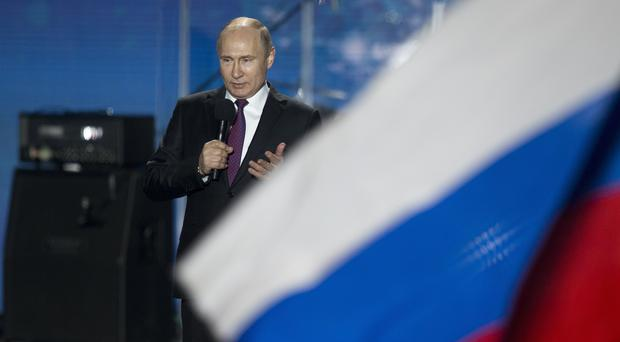 Vladimir Putin campaigns at a concert in Sevastopol, Crimea (AP Photo/Alexander Zemlianichenko)