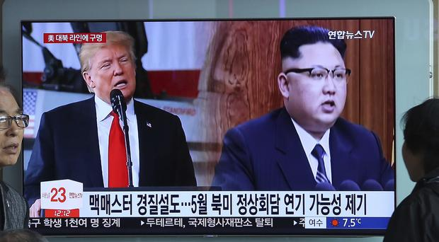 A TV screen shows North Korean leader Kim Jong Un, right, and President Trump during a news programme at the Seoul Railway Station (AP Photo/Ahn Young-joon)