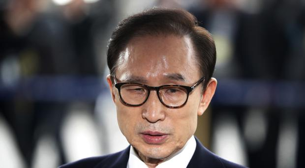 Lee Myung-bak has said the allegations are 'political revenge' (AP)