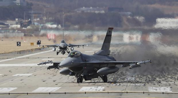 US Air Force fighter jets land at a base in South Korea (Hong Gi-won/Yonhap via AP)
