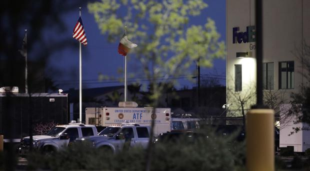 An ATF vehicle in front of a FedEx distribution centre where a package exploded in Schertz, Texas (Eric Gay/AP)