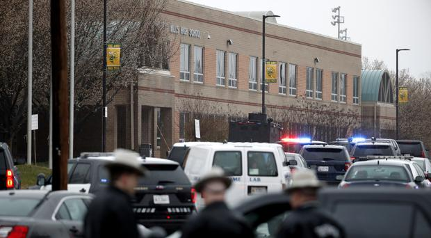Deputies and federal agents converge on Great Mills High School in Maryland after a shooting (Alex Brandon/AP)