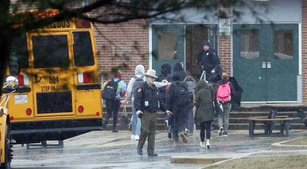 Police move students into a different area of Great Mills High School, the scene of a shooting (Alex Brandon/AP)