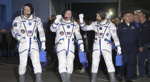 The crew heads to the spacecraft (Dmitri Lovetsky/AP)