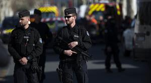 French police officers cordon off the area during an incident in Trebes (Emilio Morenatti/AP)