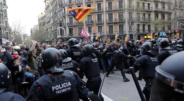 Police clash with pro-independence supporters (Emilio_Morenatti/PA)