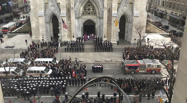 A casket carrying the body of Lt Michael Davidson is carried into New York's St Patrick's Cathedral (RIchard Drew/AP)