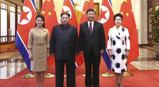 Ri Sol Ju, wife of Kim Jong Un and the North Korea leader (on left) were hosted by Chinese President Xi Jinping and his wife, Peng Liyuan (Ju Peng/Xinhua via AP)