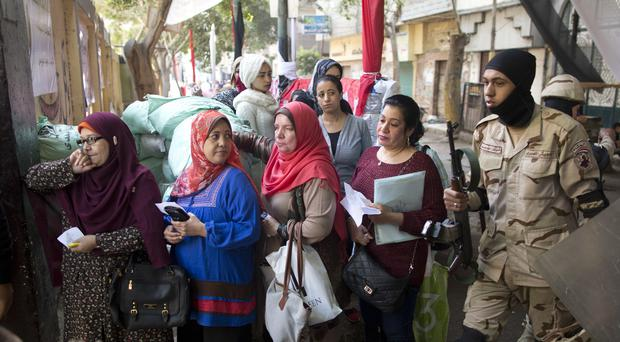Women wait to vote in front of a polling station in Cairo, Egypt (Amr Nabil/AP)