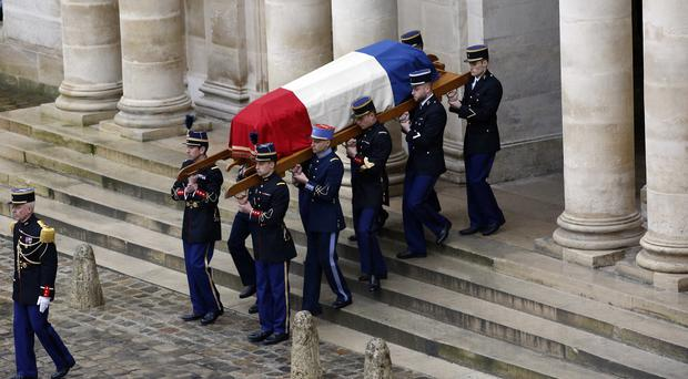 Soldiers carry the coffin of Arnaud Beltrame at the Hotel des Invalides in Paris (Christophe Ena/AP)