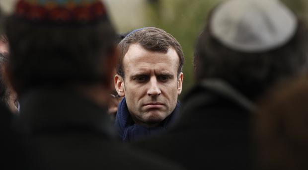 French President Emmanuel Macron attends Mireille Knoll's funeral at the Bagneux cemetery, outside Paris (Christophe Ena/AP)