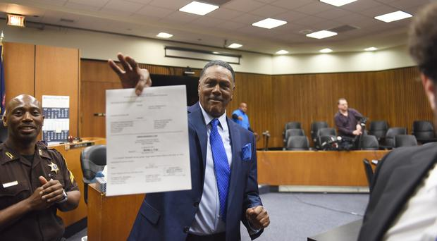 Richard Phillips shows his order of dismissal of homicide charges against him (Max Ortiz/Detroit News via AP)