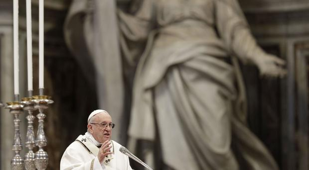 Pope Francis inside St Peter's Basilica at the Vatican (Gregorio Borgia/AP)