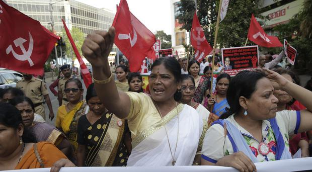 Members of Dalit organisations and leftist outfits shout slogans during a protest in Mumbai (Rafiq Maqbool/AP)