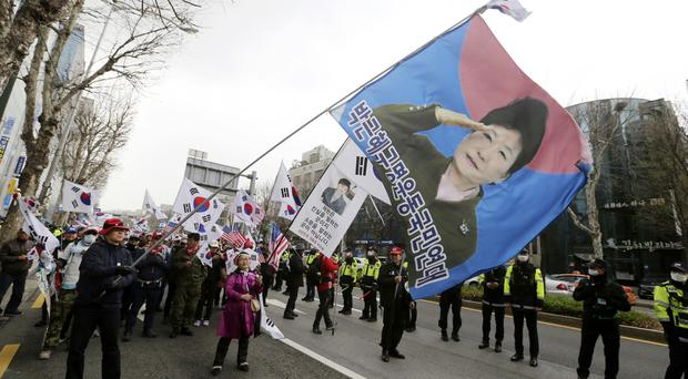 Supporters of former South Korean president Park Geun-hye rally in Seoul (Ahn Young-joon/AP)