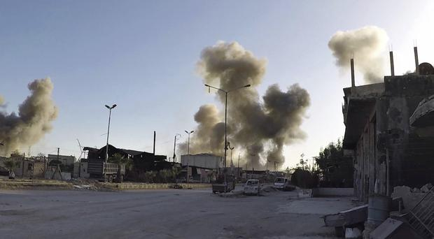 Smoke rising after Syrian government air strikes hit in the town of Douma (Syrian Civil Defence White Helmets via AP)
