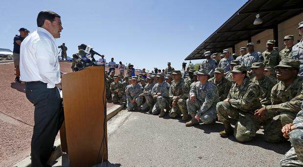 Governor Doug Ducey speaks to Arizona National Guard soldiers prior to deployment to the Mexico border (Ross D Franklin/AP)