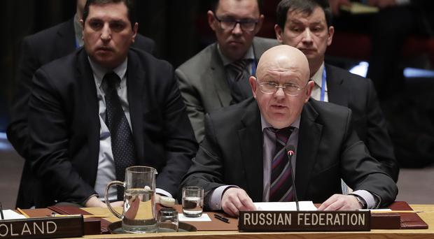 Russian ambassador Vasily Nebenzya (right) talks before a vote during a Security Council meeting (Julie Jacobson/AP/PA)