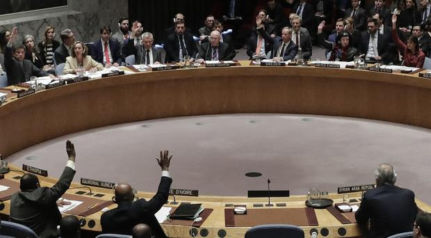 Members of the Security Council vote on resolutions to determine responsibility for chemical weapons attacks in Syria (Julie Jacobson/AP)