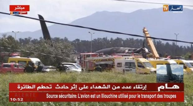 Emergency services at the scene after a military plane crashed in Algeria (ENNAHAR TV via AP)