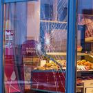 The window of a bakery is broken in Fulda (Marius Auth/osthessen-news/dpa via AP)