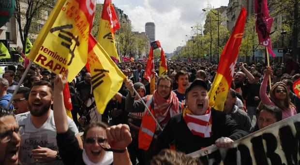 Students and rail workers march during a demonstration in Paris (AP Photo/Francois Mori)