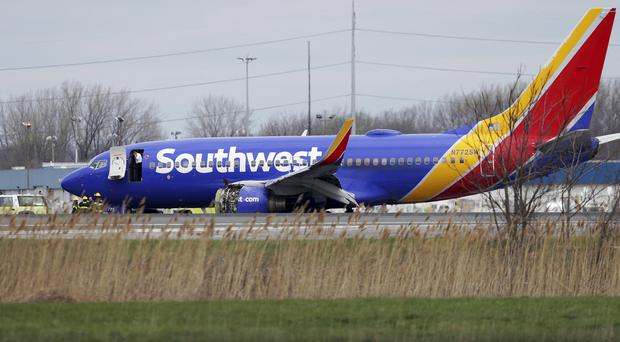 A Southwest Airlines plane sits on the runway at the Philadelphia International Airport after it made an emergency landing (David Maialetti/Philadelphia Inquirer/AP)