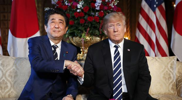 President Donald Trump and Japanese Prime Minister Shinzo Abe shake hands (Pablo Martinez Monsivais/AP)