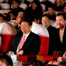 Ri Sol Ju, right, wife of North Korean leader Kim Jong Un, and Kim Yo Jong, left, his sister, watch a performance of a Chinese art troupe with Song Tao, centre, head of the ruling Communist Party's International Department (AP)