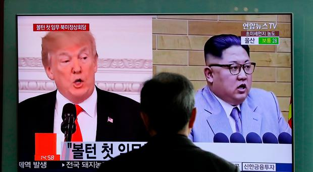 File photo of a screen showing US President Donald Trump, left, and North Korean leader Kim Jong Un (Lee Jin-man/AP)