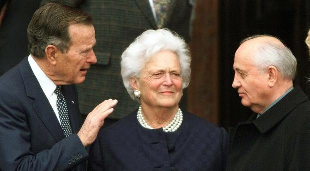 President George H.W. Bush, left, chats with former Soviet leader Mikhail Gorbachev, right, as Barbara Bush looks on (Herbert Kosnowski/AP)