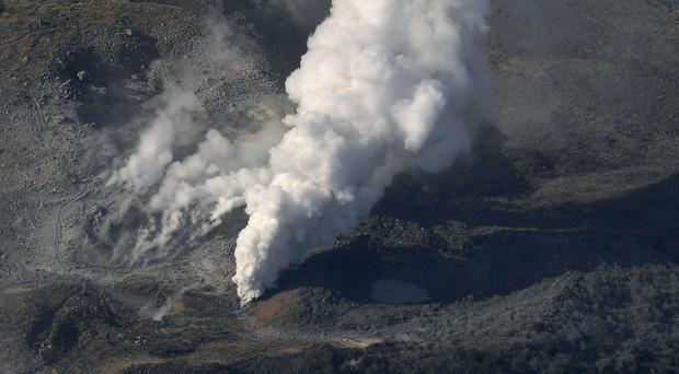 Volcanic smoke billows from Mt Io (Kyodo News via AP)