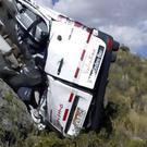 A police officer investigates the site of a minibus crash in Peru (Andina News Agency via AP)