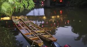 Two dragon boats that capsized sit in the water in southern China' (Chinatopix/AP)