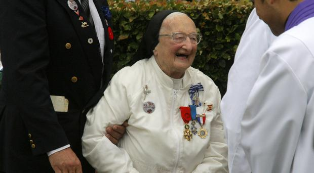 Sister Agnes-Marie Valois known as the White Angel has died aged 103 (Michel Spingler /AP)