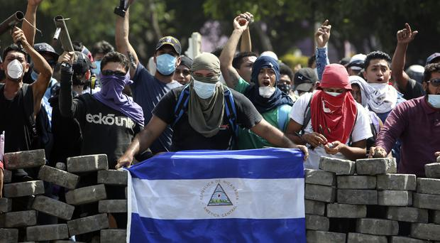 The controversial social security reforms had prompted protests and deadly clashes (Alfredo Zuniga/AP)