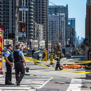 The devastating scene in downtown Toronto, where a white van mounted the pavement during a busy lunchtime