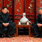 Kim Jong-un, left, meets China's ambassador to North Korea Li Jinjun, (Korean Central News Agency/Korea News Service via AP)
