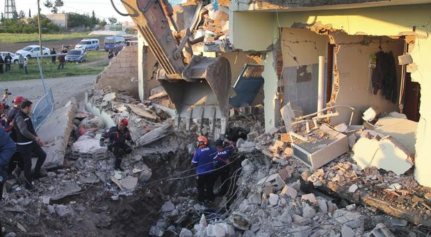 Emergency services search the rubble of houses destroyed by an earthquake, in Turkey (Mahir Alan/Depo Photos via AP)