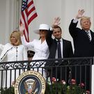 Donald Trump, Emmanuel Macron, Melania Trump and Brigitte Macron wave from the balcony of the White House (Carolyn Kaster/AP)