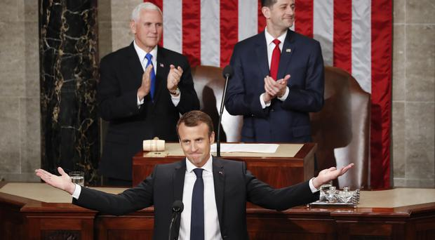 France's President Emmanuel Macron gestures as he is introduced before speaking to a joint meeting of Congress on Capitol Hill (Pablo Martinez Monsivais/AP)