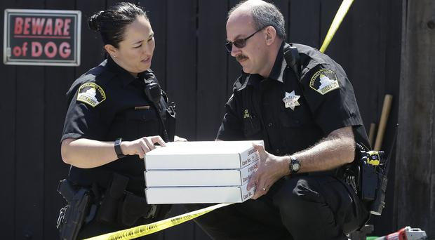 Police carry evidence gathered from the home of suspect Joseph DeAngelo (AP Photo/Rich Pedroncelli)